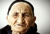 5372301-very-old-woman-face-covere-with-wrinkles-closeup-photo