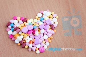 Colourful_medicines_on_wood_background7